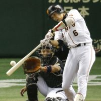 Leading the way: Giants star Hayato Sakamoto slugs a three-run home run in the seventh inning against the Tigers at Tokyo Dome. | KYODO PHOTOS