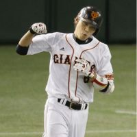 An excited Sakamoto trots around the bases as his home run gives Yomiuri a 3-2 triumph over Hanshin.