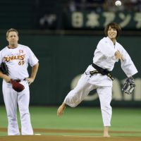 Ippon: Judo gold medalist Kaori Matsumoto throws out the first pitch prior to the Tohoku Rakuten Golden Eagles' game against the Chiba Lotte Marines on Wednesday at Tokyo Dome. | KYODO