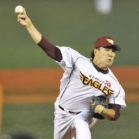 The Eagle has landed: Tohoku Rakuten's Masahiro Tanaka pitches during the Golden Eagles' 3-1 win over the Hawks on Monday. | KYODO
