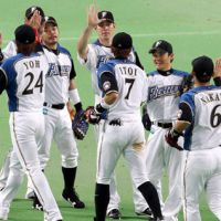 Satisfaction: Hokkaido Nippon Ham Fighters players congratulate one another after a 3-1 victory over the Chiba Lotte Marines on Thursday at Sapporo Dome. | KYODO