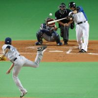 Star of the night: Fighters slugger Sho Nakata crushes a two-run home run in the first inning against the Lions on Friday at Sapporo Dome. Nakata homered twice and drove in five runs in Hokkaido Nippon Ham's 5-0 victory over Seibu. | KYODO