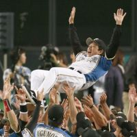 Celebration time: Hokkaido Nippon Ham manager Hideki Kuriyama (above) is tossed into the air after the idle Fighters clinched the Pacific League pennant on Tuesday. The Fighters, showing their excitement before a euphoric crowd, had a public viewing of the Chiba Lotte Marines-Seibu Lions game at Sapporo Dome, and the Lions' 5-3 loss locked up the pennant for Kuriyama's club. | KYODO