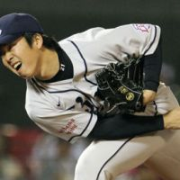 Fire at will: Seibu's Ken Togame pitches during the Lions' 4-2 win over the Golden Eagles on Wednesday night. | KYODO