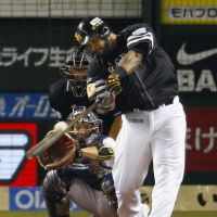 Pivotal play: Softbank's Wily Mo Pena connects for a two-run double against Seibu in Game 3 of the Climax Series on Monday. The Hawks won 3-2 to take the series 2-1. | KYODO