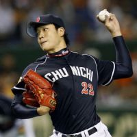 Stand tall: Chunichi's Yudai Ono pitches against the Giants at Tokyo Dome on Wednesday. | KYODO