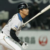 Tried and trusted: Hokkaido Nippon Ham pinch hitter Tomohiro Nioka hits a tiebreaking single in the seventh inning of the Fighters' 3-2 win over the Hawks in the opening game of the Pacific League Climax Series final stage on Wednesday. | KYODO