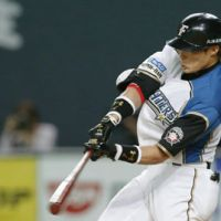 Postseason heroics: Fighters slugger Yoshio Ioti belts a two-run home run in the seventh inning against the Hawks on Thursday in Game 2 of the Pacific League Climax Series final stage at Sapporo Dome. Hokkaido Nippon Ham earned a 3-0 win over Fukuoka Softbank. | KYODO