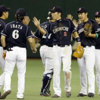 Good times: The Chunichi Dragons celebrate their 5-2 victory over the Yomiuri Giants on Thursday. | KYODO