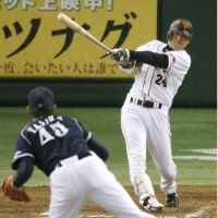 Helping his club: Giants veteran Yoshinobu Takahashi belts a two-run homer in the sixth inning on Friday. | KYODO