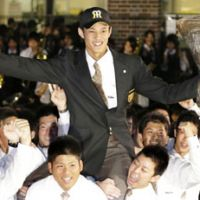 Home cooking: Osaka Toin pitcher Shintaro Fujinami celebrates after being drafted by the Tigers. | KYODO