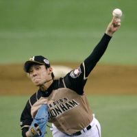 Not his best stuff: Fighters southpaw Mitsuo Yoshikawa allowed seven hits and four runs in four innings on Saturday. | KYODO