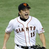 A reason to be fired up: Giants starter Hirokazu Sawamura held the Fighters to three hits, all singles, in eight innings. | KYODO
