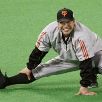 At a stretch: Giants catcher Shinnosuke Abe limbers up at Sapporo Dome ahead of Game 3 of the Japan Series. | KYODO