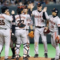 Having fun: The Giants congratulate each other after Thursday's Game 5 victory. | KYODO