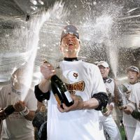 Soak it all in: Giants manager Tatsunori Hara is sprayed with beer during the team's celebration after winning the Japan Series on Saturday. | KYODO