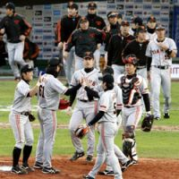 Yomiuri Giants players celebrate their first win Sunday at the Asia Series Championship after beating the Taiwan champion Lamigo Monkeys 6-3. | KYODO