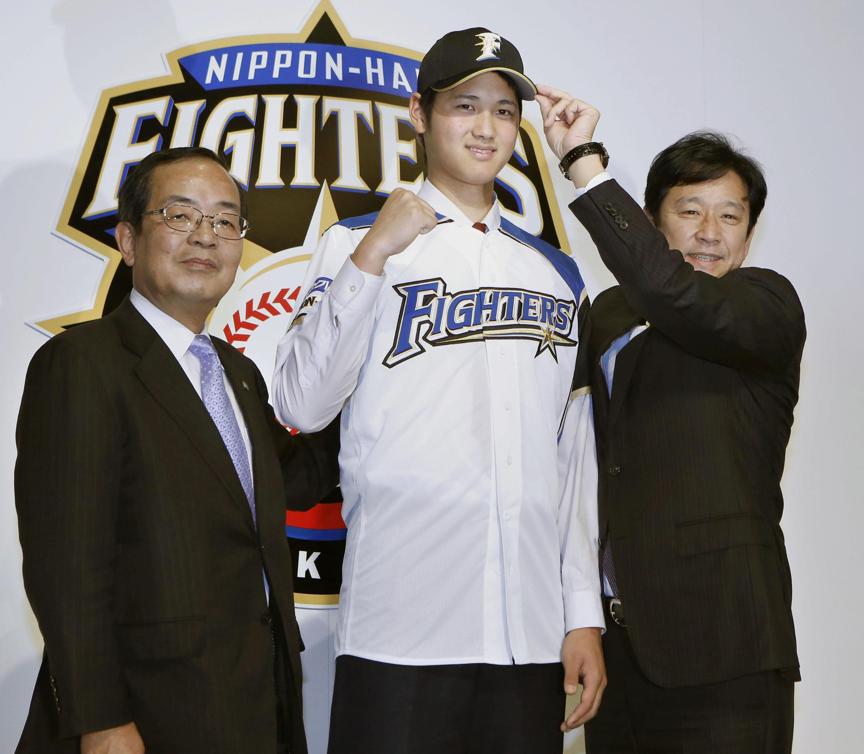 Formal introduction: Hokkaido Nippon Ham Fighters pitcher Shohei Otani meets the press on Tuesday in Sapporo after he signed a contract. | KYODO