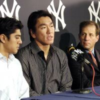 Special pairing: Agent Arn Tellem (right) appears at a news conference with Hideki Matsui in 2005 after the slugger agreed to a new contract with the New York Yankees. | NEW YORK YANKEES