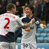On borrowed time: Bolton's Ryo Miyaichi celebrates with Gretar Steinsson after their side's F.A. Cup victory over Millwall on Saturday. Miyaichi scored the first goal in the 2-0 win. | KYODO