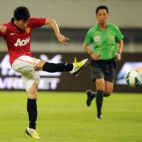 Sudden impact: Manchester United's Shinji Kagawa scores a goal against Shanghai Shenhua in a preseason match in China on Wednesday night. Man United won 1-0. | AFP-JIJI