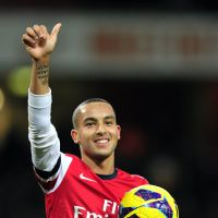 On fire: Theo Walcott salutes the crowd after scoring a hat trick against Newcastle on Saturday. | AFP-JIJI