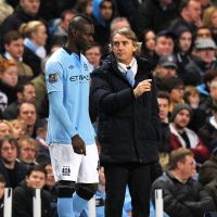 Victory needed: Manchester City manager Roberto Mancini, seen here with Mario Balotelli, has implored his side to end its 37-year drought at Arsenal in Sunday's Premier League match. | AFP-JIJI