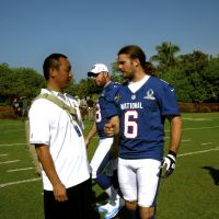 Show me the way: Kwansei Gakuin assistant head coach Kazuki Omura (left) speaks with New Orleans Saints punter Thomas Morstead on Friday in Honolulu. | KAZ NAGATSUKA