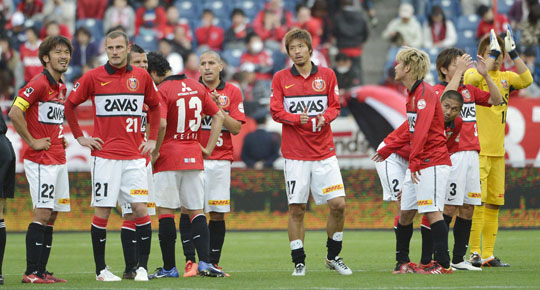 Disappointment: Urawa Reds players react after a 1-1 draw against Albirex Niigata on Saturday in the J.League. | KYODO
