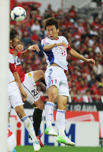 Mind games: FC Tokyo's Kazuma Watanabe heads the ball against Urawa during their match on Saturday. | KYODO