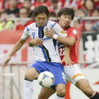Sinking feeling: Yasuhito Endo (7) was unable to prevent Gamba Osaka dropping down to the second division. | KYODO