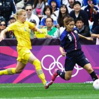 Hard fought: Japan's Nahomi Kawasumi (right) battles for the ball against Sweden's Annica Svensson on Saturday. | AP