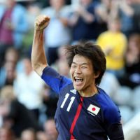 Japan beats Morocco to reach quarterfinals