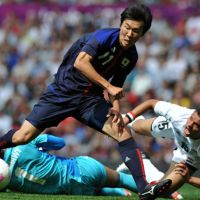 Still standing: Kensuke Nagai scores Japan's first goal during a 3-0 win over Egypt in the Olympic quarterfinals on Saturday at Old Trafford. | AFP-JIJI