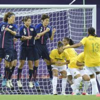 Chasing gold: Japan defends a free kick by Brazil's Francielle during the first half of their quarterfinal match on Friday in Cardiff, Wales. | KYODO
