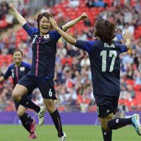 A sure thing: Mizuho Sakaguchi (left) and Yuki Ogimi, who both scored goals for Japan, celebrate Monday after Sakaguchi's decisive header in the second half of Japan's semifinal game with France at Wembley Stadium. | KYODO PHOTO