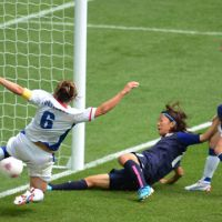 Golden opportunity: Yuki Ogimi (center) scores the opening goal in Japan's 2-1 win over France in the semifinals of the women's Olympic soccer tournament at Wembley Stadium on Monday. Japan plays the U.S. in Thursday's final. | AFP-JIJI