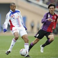 Second coming: Lucas (left) and FC Tokyo beat Kyoto Sanga in the Emperor's Cup final, in a match between two J2 sides. | KYODO