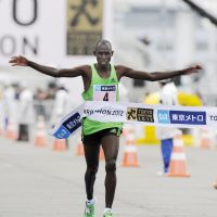 I'm done: Michael Kipyego crosses the finish line to win the Tokyo Marathon on Sunday. | KYODO