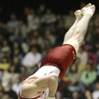 Three-time all-around world champion Kohei Uchimura spins through the air during his floor routine, on his way to his fifth consecutive title at the national all-around gymnastics championships. | KYODO PHOTO
