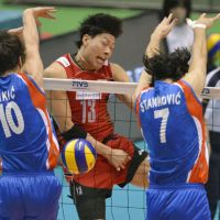 Access denied: Kunihiro Shimizu sees his spike blocked during Japan's 25-19, 25-23, 26-16 loss to Serbia in its opening match of the men's Olympic qualifiers on Friday. | KYODO PHOTO