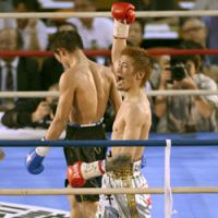 Yota Sato savors the moment after protecting his WBC super flyweight title by unanimous decision over Sylvester Lopez. | KYODO PHOTO