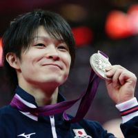 Lot of hardware: Kohei Uchimura won one gold and two silver medals during the London Olympics. | AP