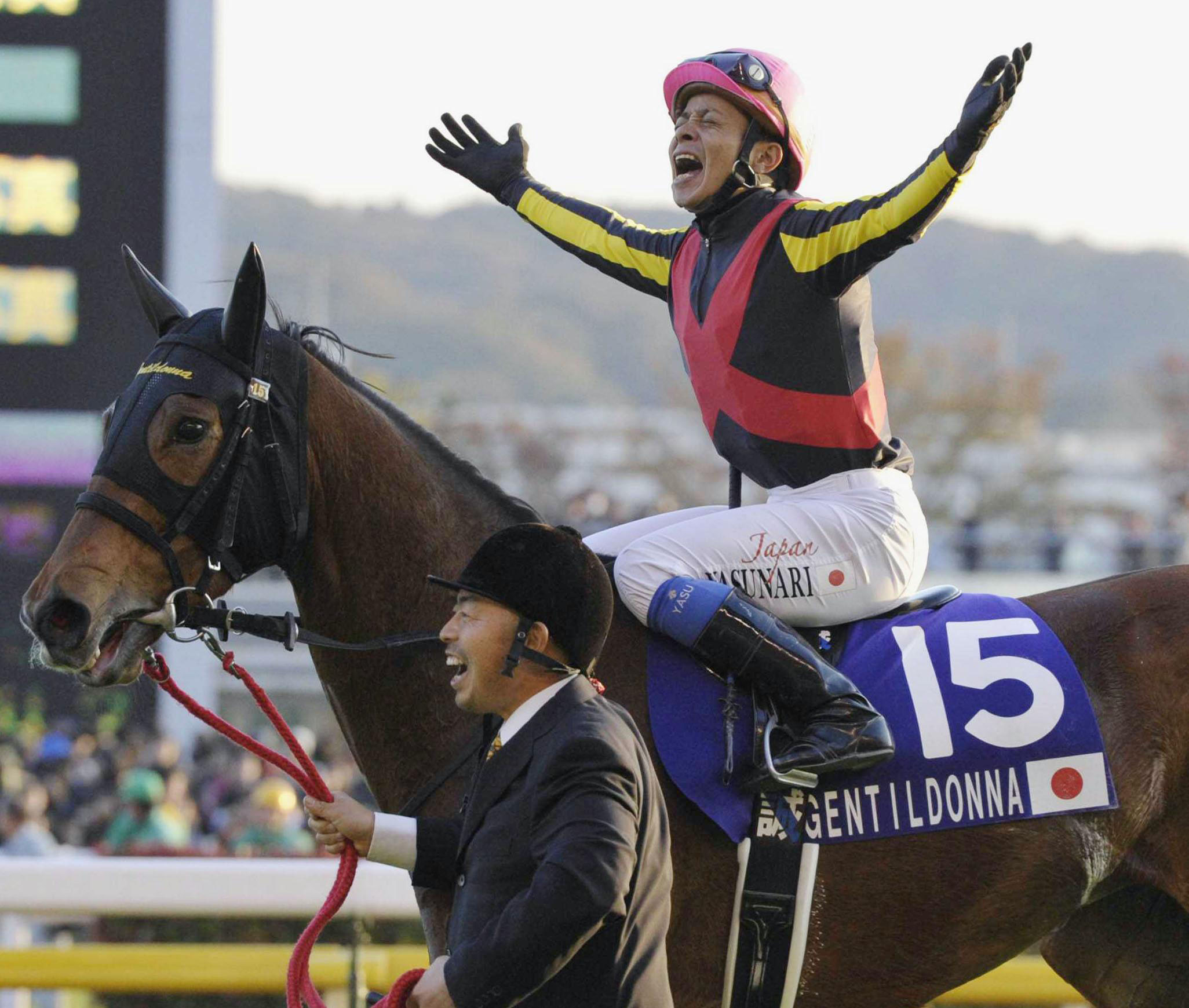 First class: Jockey Yasunari Iwata celebrates winning the Japan Cup atop Gentildonna at Tokyo Racecourse on Sunday. | KYODO