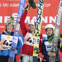 Third-place finisher Sara Takanashi poses with Austria's Daniela Iraschko (center), who tied with France's Coline Mattel for the gold at the women's ski jumping World Cup in Sochi, Russia. | KYODO
