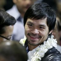 Fighting on: Manny Pacquiao arrives in Manila on Wednesday after losing to Juan Manuel Marquez in Las Vegas. | AP