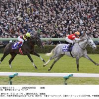 Fan favorite: Gold Ship comes home to win the Arima Kinen at Nakayama Racecourse in Funabashi, Chiba Pref., on Sunday. | KYODO