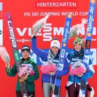 Three's company: Runnerup Sara Takanashi (left), winner Sarah Hendrickson (center) and third-place finisher Coline Mattel pose after a World Cup event in Hinterzarten, Germany. | AFP-JIJI