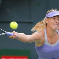 Purple haze: Maria Sharapova stretches for a shot during her 6-2, 7-6 (7-5) win over Lucie Safarova of the Czech Republic at the Pan Pacific Open in Tokyo on Wednesday. | AP