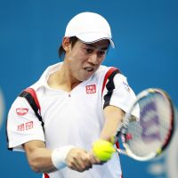 Still standing: Kei Nishikori hits a return against Ukrainian Alexander Dolgopolov in the Brisbane International quarterfinals on Friday. Nishikori won 6-4, 7-6 (7-3). | REUTERS/KYODO